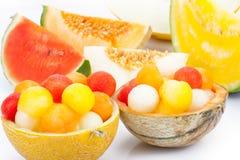 Melon as a bowl for melon balls Stock Photos