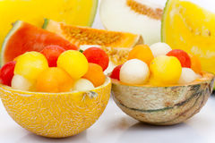 Melon as a bowl for melon balls Royalty Free Stock Image