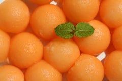 Melon Balls. Macro image of cantaloupe melon balls with a sprig of mint Royalty Free Stock Photo
