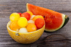 Melon balls in Bowl, made of a Melon Stock Images