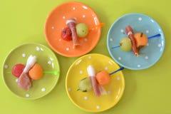 Melon balls and ham Stock Photos