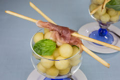 Melon balls with ham Stock Photography