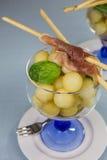 Melon balls with ham Stock Photo