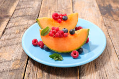 Melon and berries Stock Photography