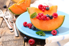 Melon with berry fruit Royalty Free Stock Photo