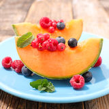 Melon with berry fruit Royalty Free Stock Images