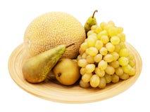 Melon, bonkrety, winogrona odizolowywający na bielu Zdjęcia Royalty Free