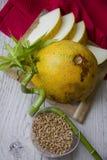 Melon on bright tablecloth Stock Photos