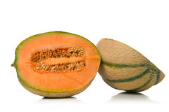 Melon cantaloupe. Freshly sliced melon over white background Stock Images