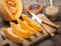 Melon. Cantaloupe melon slices on wooden background stock image