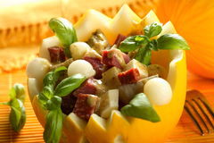 Melon with chorizo and artichokes Stock Photos
