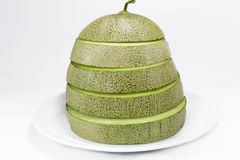 Melon. Close up slice melon with cover on white Stock Photography