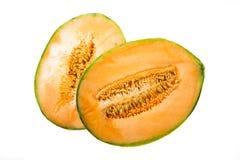 Melon coupé dans la moitié Image stock