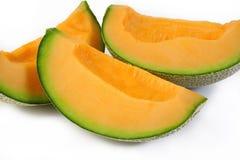 Melon coupé en tranches Photo stock
