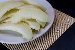 Melon coupé en tranches frais Images libres de droits