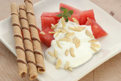 Melon with cream fresh and almond slivers Stock Images