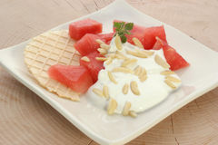Melon with cream fresh and almond slivers Stock Photo