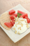 Melon with cream fresh and almond slivers Royalty Free Stock Image