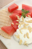 Melon with cream fresh and almond slivers Stock Photography