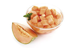 Melon cubes in bowl, close-up Stock Photo