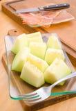Melon cut glass tray. On wood Royalty Free Stock Photo