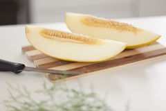 Melon on cutting board Royalty Free Stock Photography