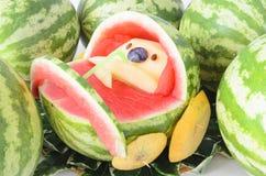 Melon et compagnons de poussette de chéri Photographie stock