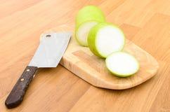 Melon et couteau d'hiver coupés Images libres de droits