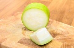 Melon et couteau d'hiver coupés Photos libres de droits
