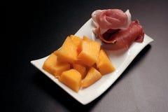 Melon et jambon photo stock