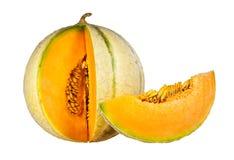 Melon et tranche d'isolement sur un fond blanc Photographie stock libre de droits