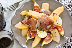Melon,Fig ,Prosciutto and Mozzarella salad Royalty Free Stock Photography