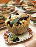 Melon filled with fresh fruit salad. Delicious fresh fruits served in bowl as dessert Stock Photo