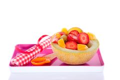 A melon filled with fruits Royalty Free Stock Images