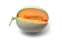 Melon fruit cut to show flesh and seeds on white background. Cut of orange Melon or cantaloupe fruit to show the flesh,seeds and peel on white background stock photography