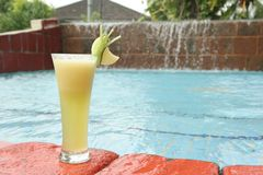 Melon fruit juice at pool Stock Photos