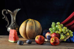 Melon and fruit on the table Royalty Free Stock Image
