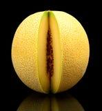 Melon galia notched isolated black in studio Stock Photo
