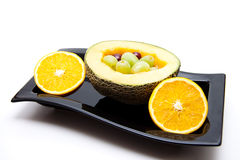 Melon with grapes and oranges Royalty Free Stock Photos