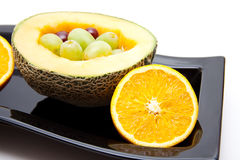 Melon with grapes and oranges Stock Photography