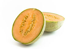 Melon halves. Two melon halves lying together on white background royalty free stock photos