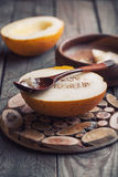 Melon. Halves of melon with wooden spoon Stock Image