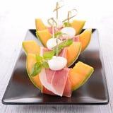 Melon,ham and mozza Stock Photography