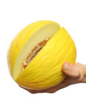 Melon in the hand. Hand with a melon on a white background Stock Photography