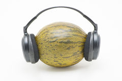 Melon with headphones Royalty Free Stock Photo