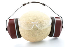 Melon in headphones  and with safet glasses Royalty Free Stock Image