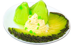 Melon Ice cream in plate isolate on white. Melon ice cream serve wiht banana and whipingcream stock photography