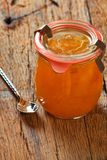 Melon jam in a preserving jar with a spoon Stock Image