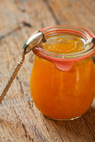 Melon jam in a preserving jar with a spoon Royalty Free Stock Images