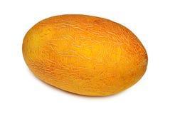 Melon jaune d'isolement sur le fond blanc Photographie stock libre de droits
